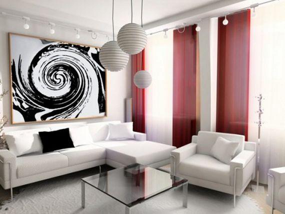 Белый интерьер гостиной с красными шторами